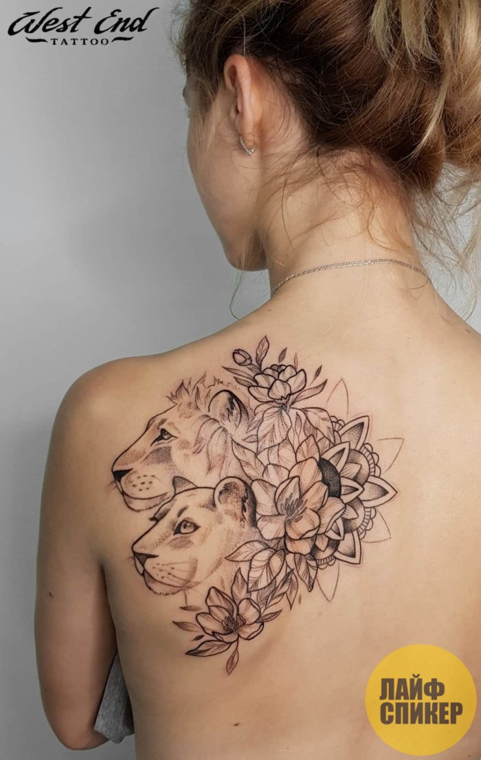 Украшение женского тела татуировками